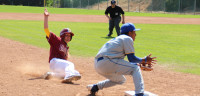 SLIDING IN SAFE: Pinch runner Max Fecske steals third at the game on Saturday.