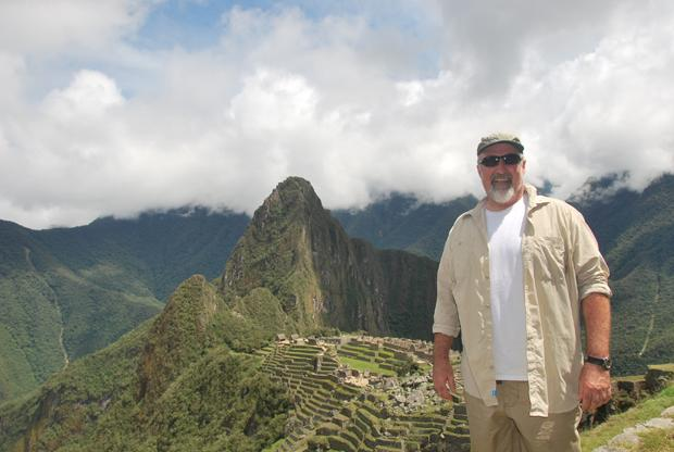 INCAN+CITY%3A+Professor+Darren+Leaver+poses+high+above+Machu+Picchu+in+Peru+on+one+of+his+many+international+trips.