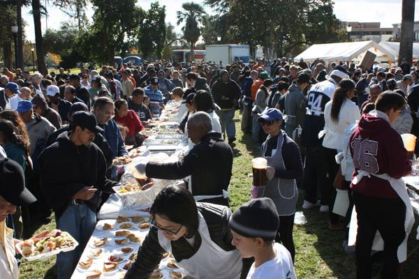 VOLUNTEERS: Union Station Homeless Services feed the hungry and less fortunate at the annual Dinner in the Park in Pasadena.