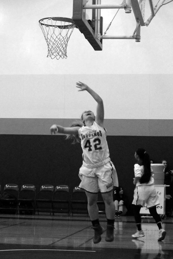 WARM+UPS%3A+Lady+Vaqs+forward+Brooke+Radcliff+leaves+the+floor+for+a+layup+before+the+game+against+Citrus+Friday.+The+Vaqs+won+52-44.
