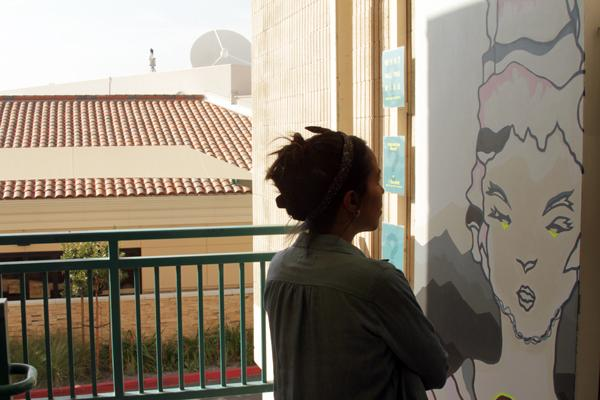 MURAL MURAL: Artist Jennifer Gurantz faces her interactive mural located outside the Aviation Arts building