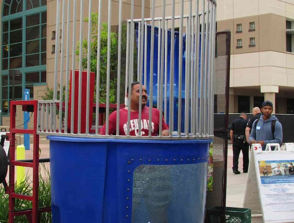 Isaac Pedraza getting dunked at the transfer celebration ceremony May 10 at Plaza Vaquero.