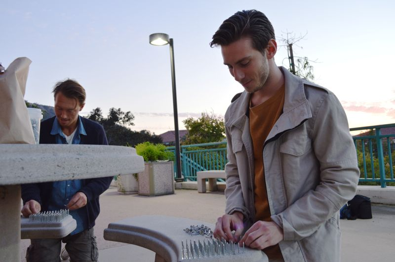 Fredrick Coling and Emil Rasmussen set up nails for their sculpture project.