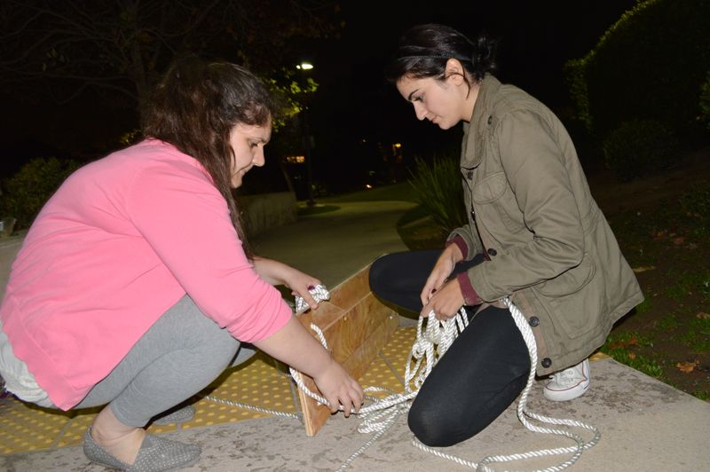 Tatevik Iskandaryan and Meline Ter-Oganesian setting up a swing for their sculture project.
