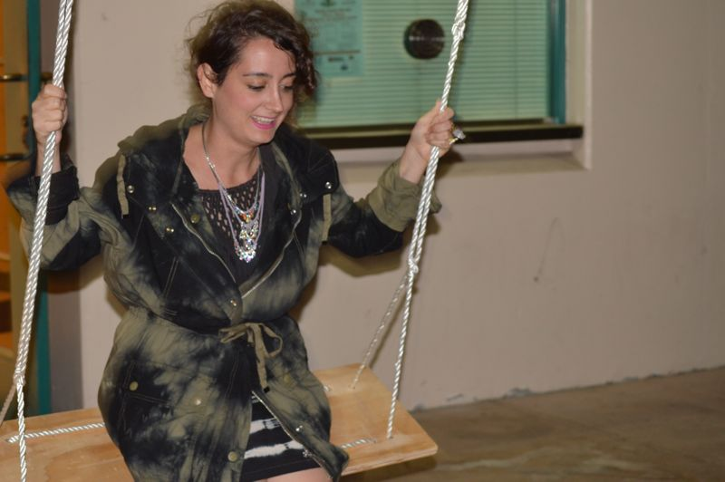 Maral Janoyan swinging on a fellow students sculputre project in front of the campus police office.