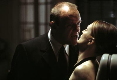 Dr. Lecter intimidates Starling.