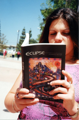 - Photo by Iain MortonGlendale student Lala Bedrosian reads last year's edition of