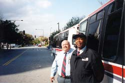 David Escobar, left, and Dennis Reeves both drive the nearly empty shuttles.