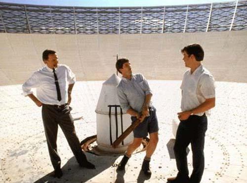 Tom Long, left, Patrick Warburton, Sam Neill, and Kevin Harrington contemplate Apollo 11's flight path in