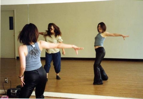 -Photo by Roderick DanielsNamoi Nakamura, foreground, and Izumi Takiguchi dance in front of a mirror.