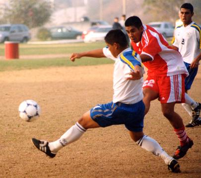 Hector Romero, 22, and a Hancock player battle for the ball during Hancock's 6-1 win over GCC on Tuesday.