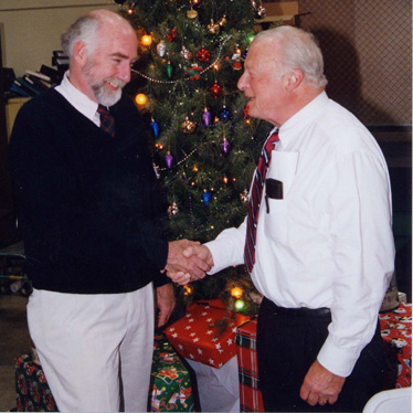 Dr. Chris McCarthy, left, is congratulated by GCC President Dr. John A. Davitt at the Thursday luncheon.