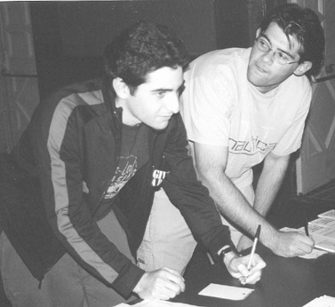 GCC students Vicken Jabourian and Albert Iskander sign in at the voting polls in the Auditorium during Tuesdays election. Measure G received 12,627 votes from Glendale voters.