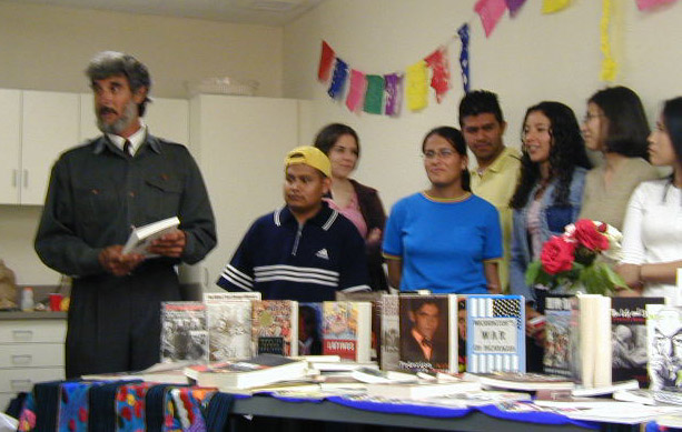 Carlos Ugalde and ALAS members present the 63 Latin American studies books to the library at a reception May 16.