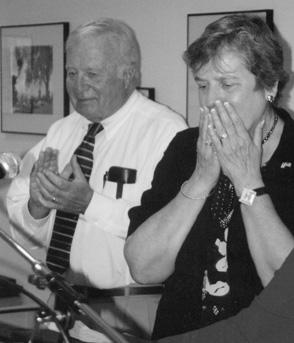 Faculty member Karen Warten, right with campus president Dr. John A. Davitt, is overwhelmed with emotion as she wins the John Davitt Award.