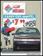 Associated Press   Get the door Dominos Pizza delivery driver Gary Moffett, of Detroit, makes a pizza run from a Detroit Dominos location over the weekend. Although this location still provides free delivery, Dominos is now testing a deliver