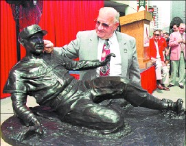 Associated Press Hall of Famer Enos Country Slaughter admires a statue of himself depicted in his playing days. Slaughter died Monday morning at the age of 86.