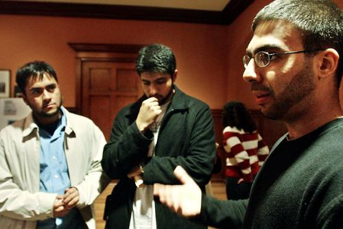 Muhammed Mekki, president of the Muslim Students Association, right, discusses the war in Iraq. Mekki, an Iraqi American, has been active in Islam-related issues on campus.  [Michael Lupoli/The Daily Pennsylvanian]
