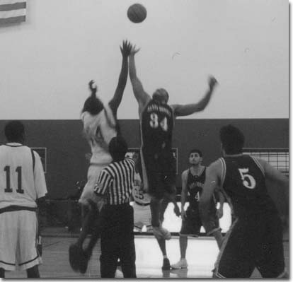 Photo by Ramtin Jamshidi    Williams out-jumps Dexter Manley of the Corsairs and outplayed everyone on the floor with a game high of 25.