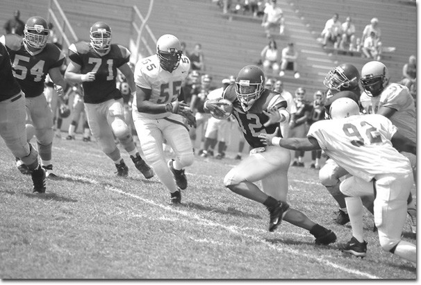 Photo by Cynthia Perry    Quarterback Kenneth McDaniel, middle, was harrassed into many scrambles by the top ranked Cougar defense.