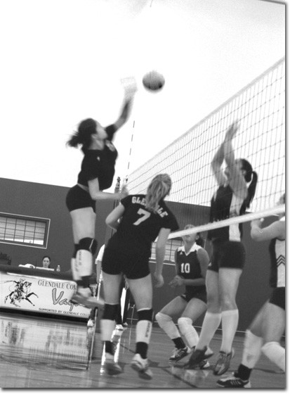 Photo by Cynthia Perry    Samantha Rivero (left) spikes the ball on a Lindsay Kline set.