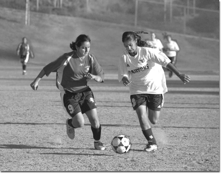 Photo by Elizabeth Linares  Joanna Andrade, left, chases down a ball against a College of the Canyons forward in a 4-1 Vaquero loss.