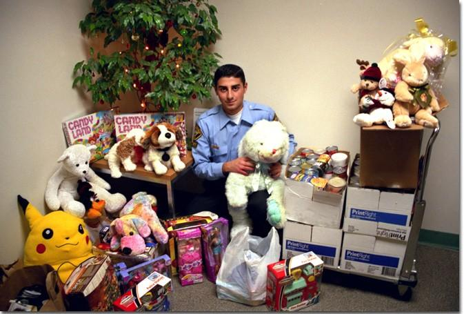 GCC police cadet Edgar Zabunyan, 20, helps the Glendale community by giving out Christmas gifts to those in need.