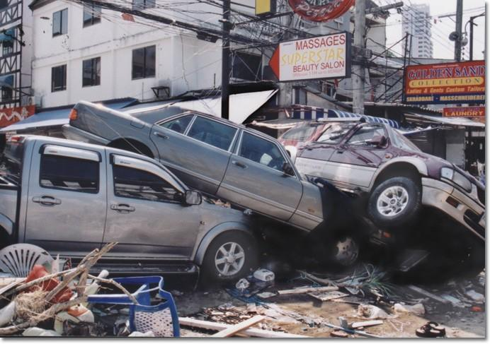 TSUNAMI DAMAGE — Powerful waves left cars looking like childrens toys stacked on top of each other.