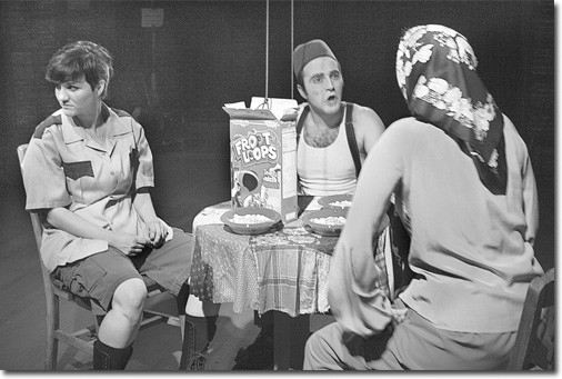 Rachelle Horak, as Wendy Burger, turns away from the argument between R. B. Dilanchian, as Hazar, and Mary Sullivan, as Jen-ya, in a scene from the theater art department's production of