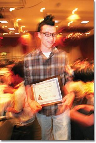 Benjamin Grenard smiles as he picks up his award at JACC.
