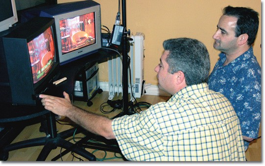 Technicians Ander Andre Minasian, left, and Bruce Heinsius check their settings before filming a segment for