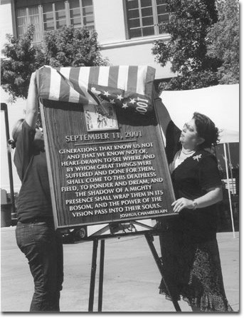 Edit Keshishian, Vice President of Campus Activities (left) and President of the Board of Trustees Dr. Armine Hakopian unveil the Sept. 11 plaque during a 2003 ceremony commemorating the second anniversary of the Sept. 11 attacks on New York and Washingto