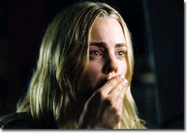 Kathy Lutz, played by Melissa George, shocked at the realization that her dream home becomes a house of horror.