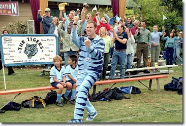 Phil Weston (Ferrell) lets winning get to his head as he cheers on his Tigers squad in a Tiger suit.