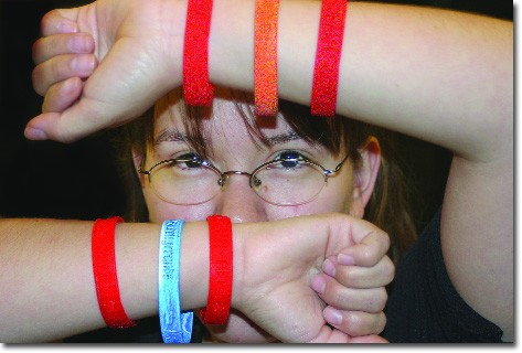 Glendi Gomez wears the colored bracelets that have become popular all over the United States.