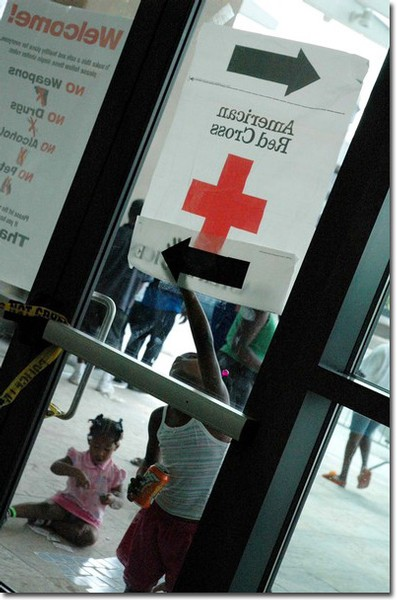 Families with children are among the hundreds of Hurricane Katrina victims seeking shelter at the Baton Rouge River Center. The Red Cross is pleading for volunteers and donations to assist their disaster relief effort.