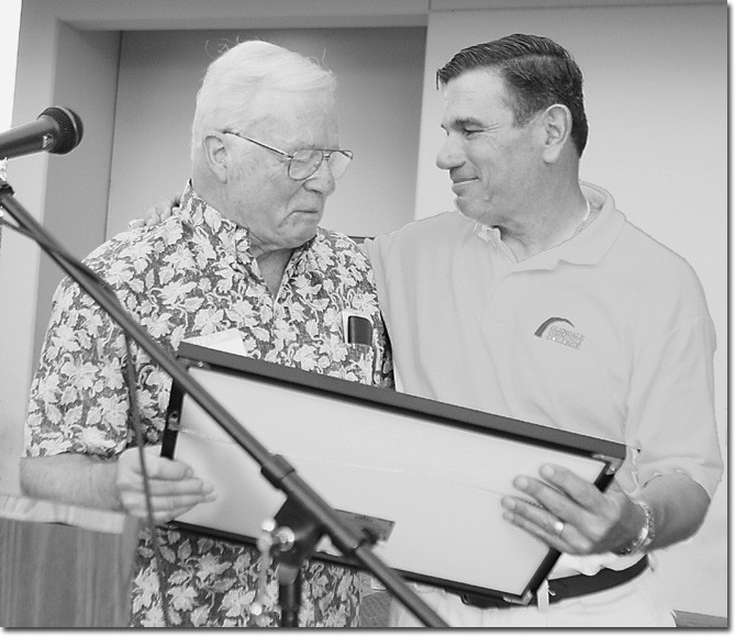 GCC President John Davitt, left, and Jim Sartoris at the field dedication ceremony.