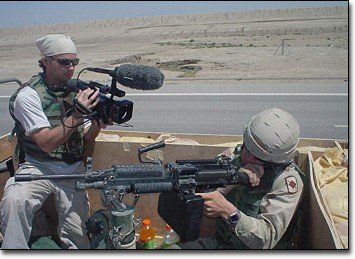Craig Renaud films an Arkansas National Guard soldier in the back of a Humvee during the ride from Kuwait to Camp Cooke.