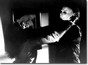 Laurie Strode (Jamie Lee Curtis) in the grip of Michael Myers (Nick Castle) in Compass International Pictures'