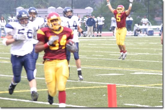 Jamal Rashad scores a touchdown against West Los Angeles College. Quarterback Steve Martinez celebrates.