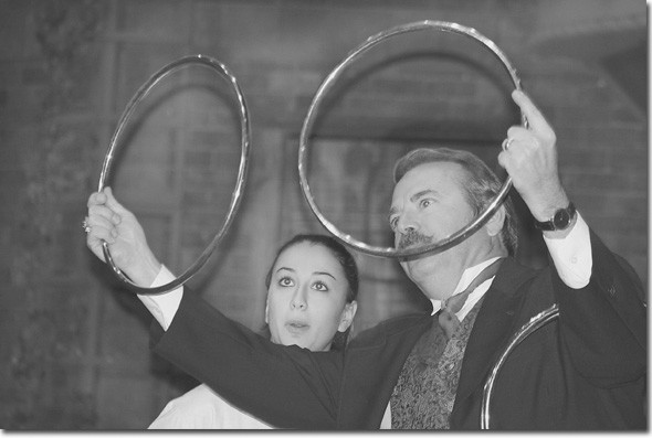 Nune Aleksanyan is surprised by Magician Whit Haydn's linking rings trick.