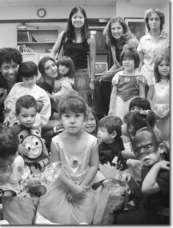 The 3- and 4-year-old Crickets show off their colorful Halloween costumes. Front row, from left: Jean Luc, Adam, Emma, Gigi, Lucas, Victoria, and Max. Back row: Cricket teacher Sylvia Turrentine, Jeremy, Cricket teacher Tatiana Zargarian, Chelsea, Jacquel