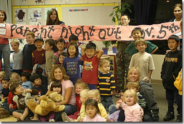 Kids at the Child Development Center frolicked at a pajama party while their parents' donations supported breast cancer awareness. Bottom row L-R: Emilio, Jean Luc, Melanie, Adam, teacher Leslie Miitchell, Chelsea, Reese, Anna, Claire, Sarah, Mira and t