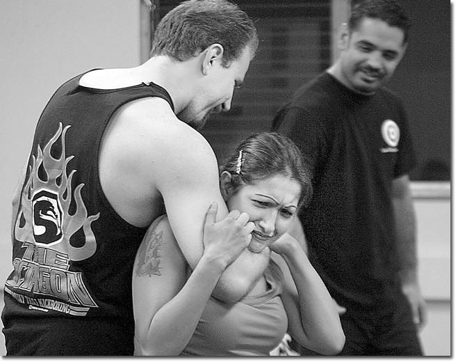 Mark Ragonig simulates choking self-defense student Ixtlizachitl