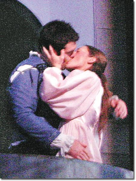 Star-crossed lovers Romeo, Nicholas Helack, and Juliet, Zarah Mahler, share a romantic kiss.