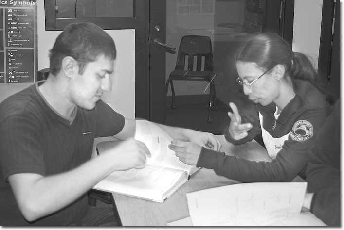 Hard at work, Ana Trujillo gives a tutoring session to Karapet Alakeyan in the High-Tech Center.