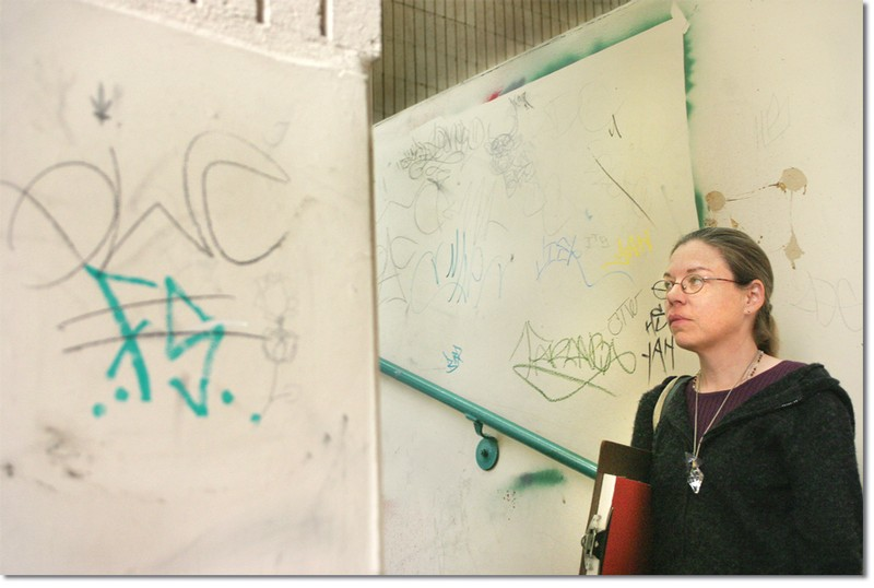 Britta Amunsen, an art student, on her way to a class in the heavily graffitied Aviation/Art building.