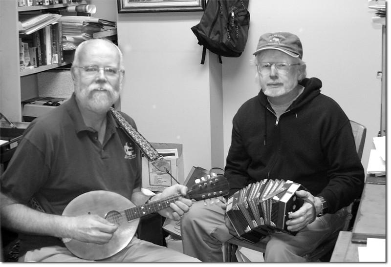 Dennis Doyle, on mandolin, and Desmond Kilkeary, on concertina, enjoy a traditional Celtic jam session.