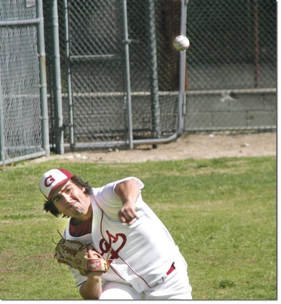 Trey Laselle-Castro warms up in the bullpen before facing Mission College. The Vaqueros lost 9-6.