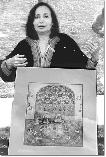 Persian artist Badri Borghei displays work at the Norooz celebration.